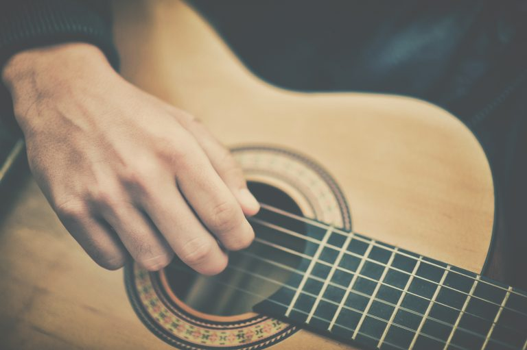 Hand on guitar 768x511